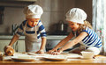 Happy Family Funny Kids Bake Cookies In Kitchen Stock Photos - 84388603