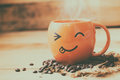 Smile Face Hot Coffee Cup With Bean On Wood Royalty Free Stock Photography - 84391097