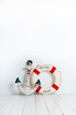 Anchor And Life Buoy On A White Wooden Floor Royalty Free Stock Photography - 84410407