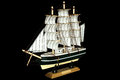 Ship Sailboat Wooden Model On A Black Background Stock Photo - 84412520