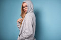 Cute Positive Blonde Woman In Gray Hoodie And Glasses Royalty Free Stock Image - 84422406