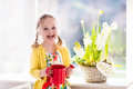 Little Girl Watering Spring Flowers Stock Photo - 84434550