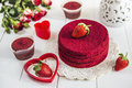 Red Cake Without Cream `red Velvet` On A White Wooden Table, Decorated With Strawberries, Roses And White Openwork Vase With A Hea Stock Photos - 84452003