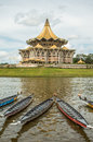 Kuching, Malaysia, Parliament Building And Longboats Under The Water Festival Regatta. Royalty Free Stock Photo - 84531905