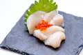 Hotate Scallop Sashimi Served With Ikura Salmon Roe And Sliced Radish On The Black Stone Plate Stock Image - 84538271