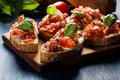 Italian Bruschetta With Roasted Tomatoes, Mozzarella Cheese And Royalty Free Stock Images - 84545919