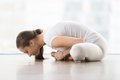 Young Attractive Woman In Baddha Konasana Pose Against Floor Win Stock Images - 84575754