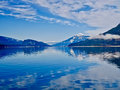 Blue Lake And Blue Snowy Mountains. Stock Photo - 84630730