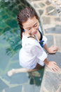 Asian Woman In Hotel Swimming Pool Relaxing Vacation Travel, Young Girl Enjoying Spa Royalty Free Stock Image - 84660426