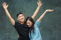 Portrait Of Smiling Korean Couple On A Gray Royalty Free Stock Photo - 84661185