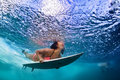 Active Girl In Bikini In Dive Action On Surf Board Royalty Free Stock Photo - 84675135