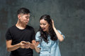 Asian Young Couple Using Cellphone, Closeup Portrait. Royalty Free Stock Photo - 84716155
