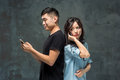 Asian Young Couple Using Cellphone, Closeup Portrait. Royalty Free Stock Photos - 84717818