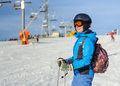 Portrait Of Young Happy Woman Skier At The Ski Resort Stock Photo - 84734530