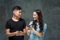 Asian Young Couple Using Cellphone, Closeup Portrait. Stock Image - 84736441