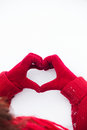 Heart Sign On Snow Hands In Red Gloves Stock Photo - 84749830