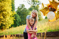Mother And Her Little Son With Gold Balloons In Summer Day. Happy Family Mom And Kid Hugging Stock Photos - 84774433