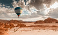 Hot Air Balloon Travel Over Desert Royalty Free Stock Photos - 84784468