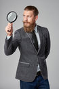 Serious Hipster Business Man With Magnifying Glass Stock Photo - 84797490