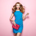 Blonde Young Woman In Elegant Blue Dress Stock Images - 84798974