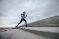 Woman Running On Steps Outdoors Royalty Free Stock Images - 84820229