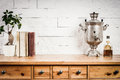 Shelf With A Book And A Flower And A Kettle Royalty Free Stock Photos - 84825388