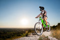 Cyclist With Mountain Bike On The Hill Under Blue Sky Royalty Free Stock Image - 84838676
