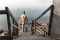 Man Stands On Old Wooden Stairway Stock Photography - 84850182