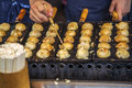 Takoyaki Being Grilled At A Street Food Stall In Osaka, Japan Stock Photography - 84889092