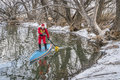 Winter Stand Up Paddling Royalty Free Stock Photography - 84931007