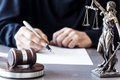 Scales Of Justice With Judge Gavel On Table Royalty Free Stock Images - 84940459