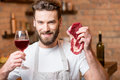Man With Raw Meat Royalty Free Stock Photos - 85049638