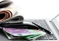 Ecommerce Earnings Whit Newspapers, And Money On A Laptop Royalty Free Stock Images - 85073319