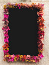 Flower Framed Around Chalkboard On Stone Wall Stock Images - 85095364
