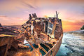 Corroded Metal Ship On The Blue Sea Water At Sundown Stock Photo - 85129280