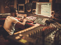 African American Sound Engineer Working At Mixing Panel In Boutique Recording Studio Royalty Free Stock Photography - 85134987