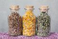 Dried Teas Herbs Inside Glass Bottles. Stock Photography - 85160202