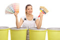 Cheerful Female Painter With Color Swatch And Paintbrushes Royalty Free Stock Images - 85161939