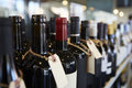Bottles Of Wine On Display In Delicatessen Royalty Free Stock Photography - 85186217