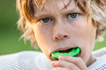 Boy Putting In His Mouth Guard Stock Images - 85216564
