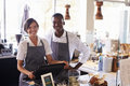 Portrait Of Staff Working At Delicatessen Checkout Royalty Free Stock Photo - 85217985