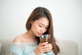 Beautiful Young Asian Woman Drinking Her Morning Tea Over A Brea Stock Photo - 85245410