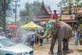 AYUTTHAYA, THAILAND - APR 14: Revelers Enjoy Water Splashing With Elephants During Songkran Festival On Apr 14, 2016 In Ayutthaya, Royalty Free Stock Images - 85252389