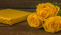Yellow Roses And Gift Box  On A Old Wooden Table Royalty Free Stock Photo - 85253435