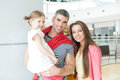 Father And Mother Pose With Young Daughter In Shopping Mall Stock Photo - 85274270
