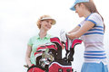 Low Angle View Of Happy Female Golfers Talking Against Clear Sky Royalty Free Stock Photos - 85308118