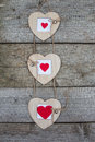 Three Wooden Heart Hanging On A Rope. Photo Frame Royalty Free Stock Images - 85316969