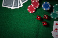 Poker Chips And Gamble Cards On Casino Green Table With Low Key Stock Photo - 85317230
