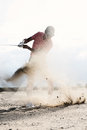 Middle-aged Man Splashing Sand While Playing At Golf Course Stock Photos - 85320483