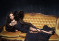 Sexy And Beautiful Woman In Black Dress On A Sofa. Stock Photography - 85331782